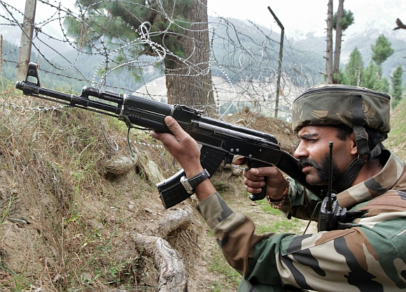An Indian army soldier take his position near his camp after a gun battle with suspected militants in Gurez, 160 km from north Srinagar