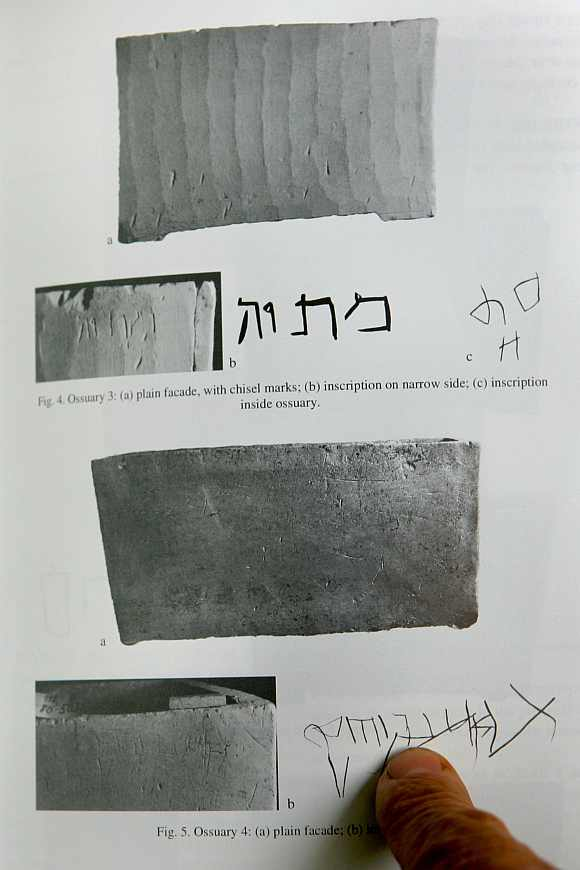 Israeli archaeologist Professor Amos Kloner points to the inscription Yeshua son of Yehosef (Jesus son of Joseph) on an ossuary
