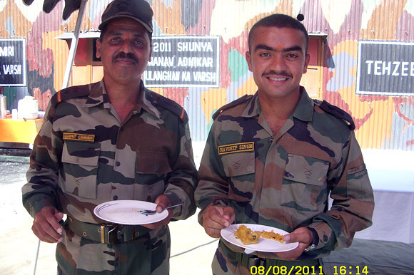 Lieutenant Navdeep, right, at his unit, 12 days before he was martyred