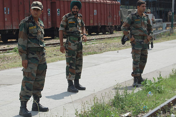 Lieutenant Navdeep, left, with colleagues during a unit movement
