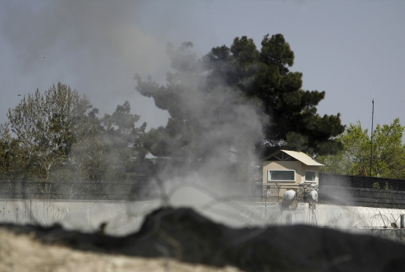 Smoke rises from a tower belonging to the British embassy after gunmen launched multiple attacks in Kabul