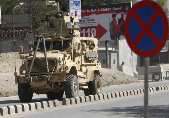 US troops arrive at the scene after gunmen launched multiple attacks in Kabul