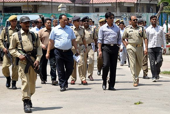 Police personnel supervise the security set-up ahead of PM Singh's visit to Guwahati on April 20