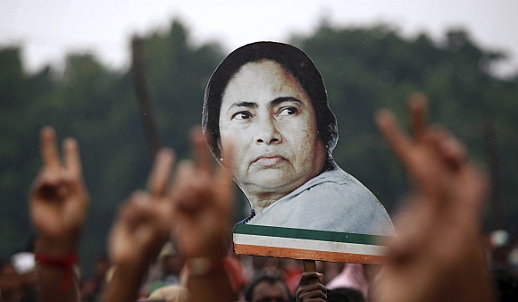 Supporters hold a cut-out of Mamata Banerjee during a rally in Kolkata
