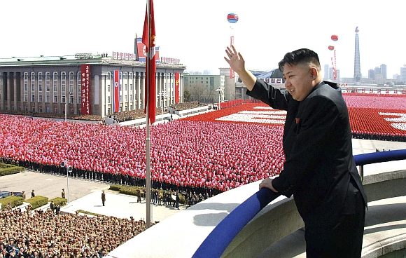 North Korean leader Kim Jong-Un waves his hand to the people during a military parade held to celebrate the centenary of the birth of the North's founder Kim Il-Sung in Pyongyang