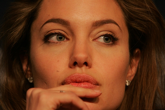Angelina Jolie looks on during a news conference at the World Economic Forum in Davos