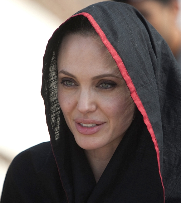 Angelina Jolie wears a headscarf as she arrives at the Jalozai flood victim relief camp during her visit to flood affected areas and relief camps supported by the UNHCR in Pakistan's northwest Khyber-Pakhtunkhwa province