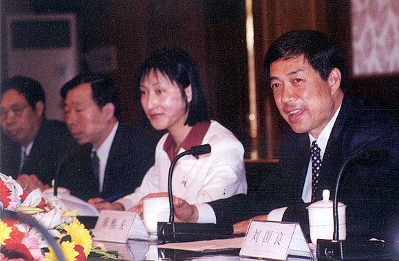 Bo Xilai, then the Mayor of Dalian, in his office. The lady is his interpreter.