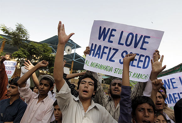 Supporters of Al Muhammadia Students, a religious group, shout slogans while taking part in an anti-American rally in Karachi