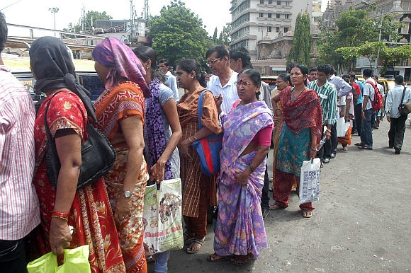 Commuters line up at Kurla bus stand
