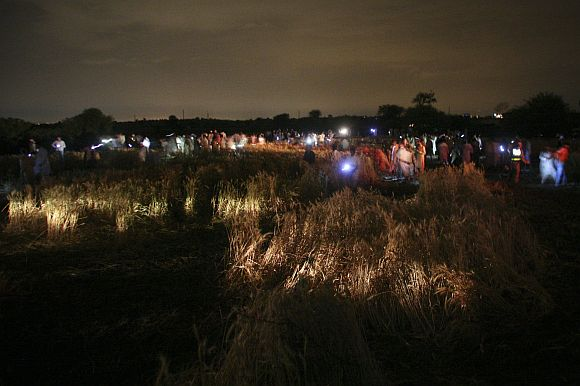 The field where the Boeing 737 airliner crashed is seen at night
