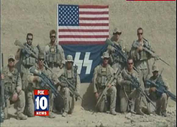 Video grab of US soldiers posing with Nazi-styled flag