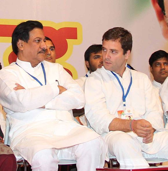 Rahul Gandhi speaks with CM Chavan during a conference at Ville Parle, Mumbai on Friday