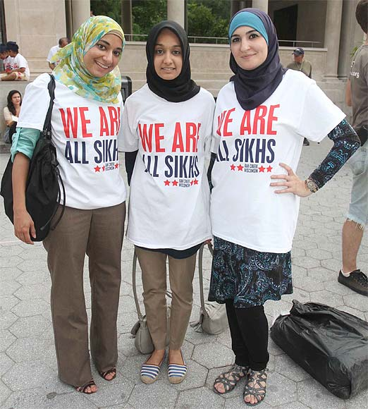 Muslim girls participate in the vigil held in New York to condemn the  Wisconsin shooting