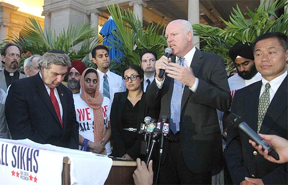 US Congressman Joe Crowley addresses the crowds at the vigil