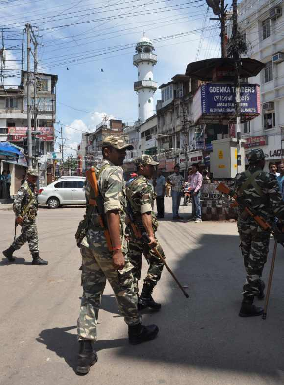 Army personnel patrol disturbed areas in Kokrajhar district in Assam