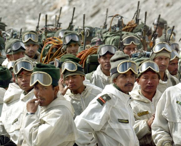 Indian army soldiers muster at their base camp after returning from training at Siachen Glacier