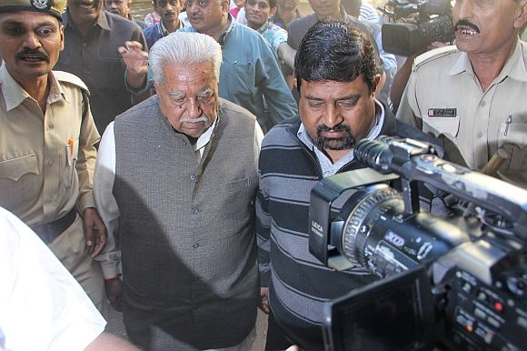 Gujarat Parivartan Party chief Keshubhai Patel arrives to cast his vote