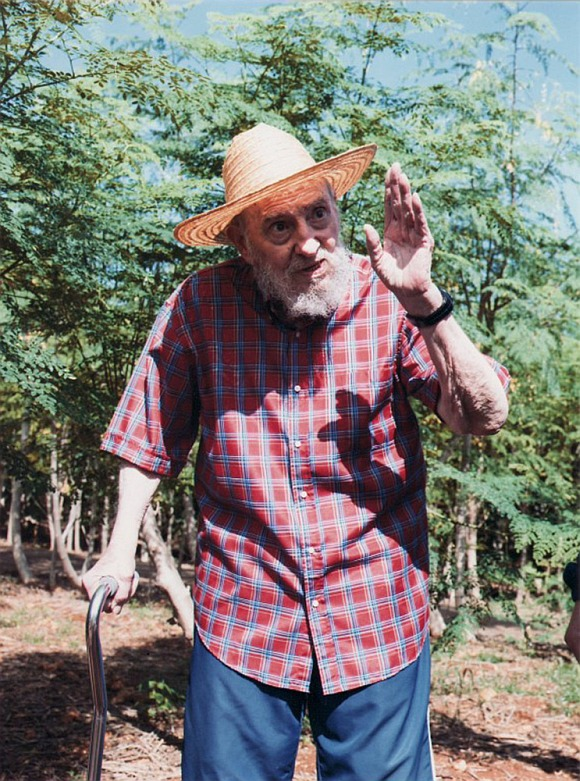 Former Cuban leader Fidel Castro waves in Havana in this picture released by Cuban website Cubadebate