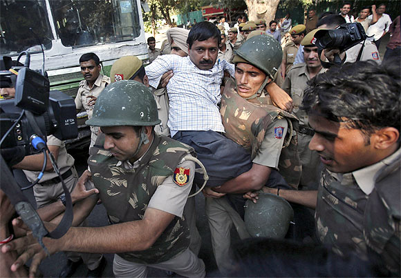Arvind Kejriwal being detained by the police during a protest march in New Delhi