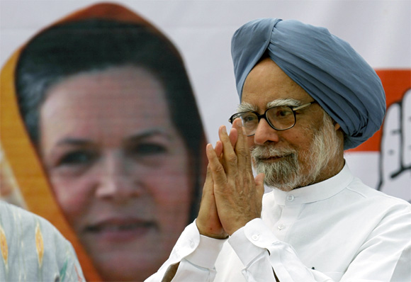 India's Prime Minister Manmohan Singh gestures to supporters of the Congress Party during a rally in Ahmedabad