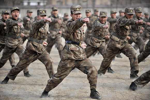 Recruits from the People's Liberation Army attend a training session at a military base