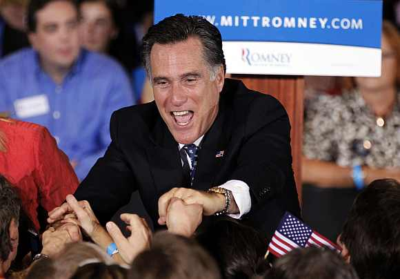 US Republican presidential candidate and former Massachusetts Governor Mitt Romney shakes hands with supporters after speaking at his Florida primary night rally in Tampa, Florida