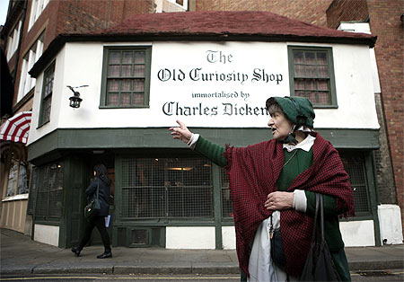 A guide gives a Charles Dickens tour in London