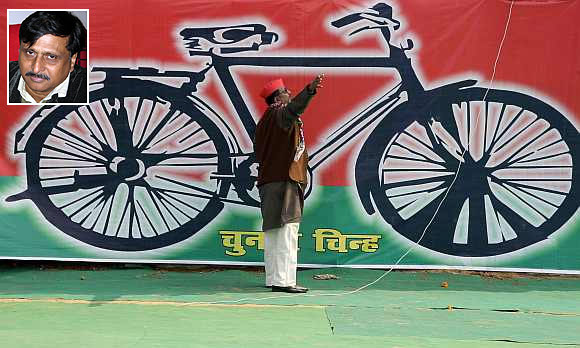 Main image: The Samajwadi Party symbol. Inset: Professor Rajesh Misra, head of the department of sociology at Lucknow University