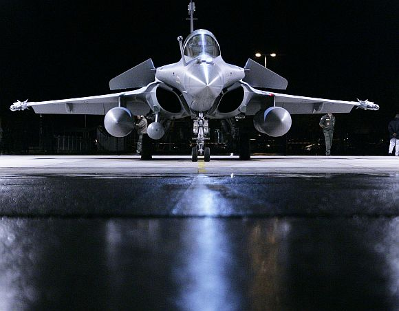 A French Dassault Rafale fighter jet is prepared for a night flight at the Swiss Army Airbase in Emmen, central Switzerland