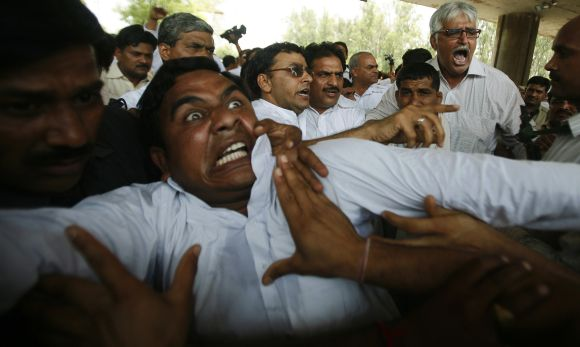 Farmers scuffle with police during a protest march at Noida in UP