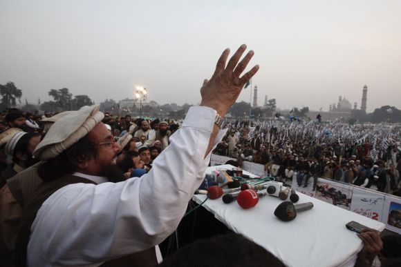 Hafiz Saeed speaks to gathering during an anti-American and Indian rally on the grounds of the Minar-e-Pakistan in Lahore