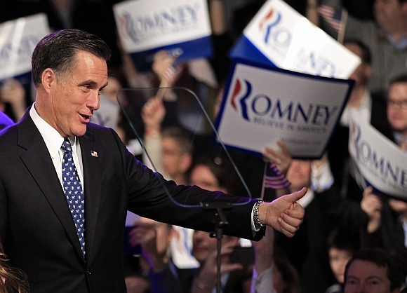Republican presidential candidate andf former Massachusetts Governor Mitt Romney greets supporters at his New Hampshire primary night rally in Manchester, New Hampshire