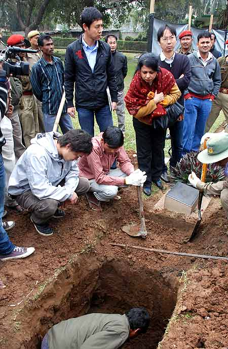 A team of Indian and Japanese officials oversee the exhumation