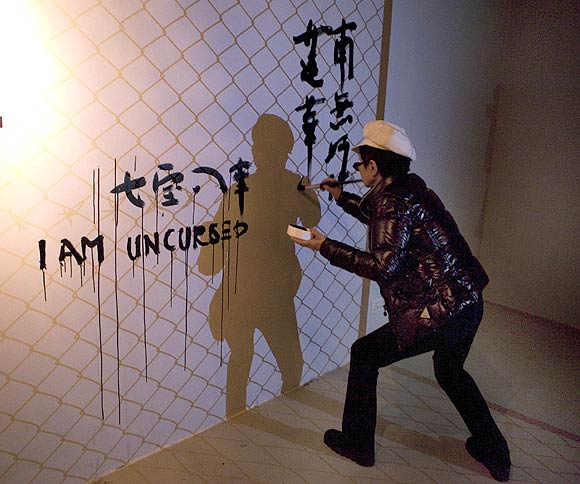 Ono puts up the Remember Us installation at New Delhi's Vadhera Art Gallery. She painted the words 'I am uncursed' in different languages on one wall