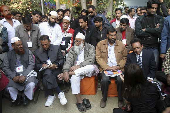 Members of various Muslim organisations sit before a televised speech by Salman Rushdie which was cancelled at the annual Literature Festival in Jaipur.