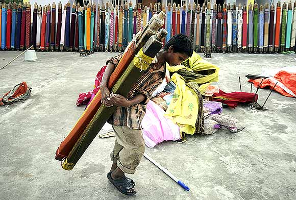A young boy with rolls of saris in Hyderabad
