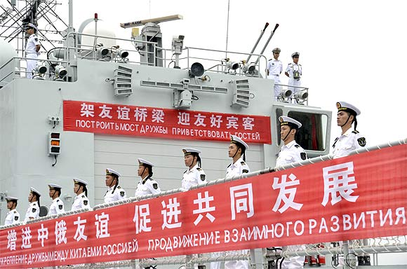Sailors line up onboard a Chinese warship