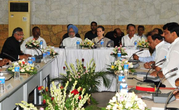 PM Singh, Congress chief Sonia Gandhi and CM Gogoi discuss the flood crisis with authorities during a meeting in Guwahati on Monday