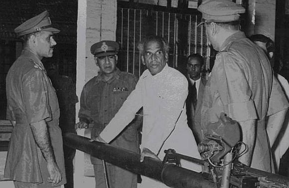 V K Krishna Menon, then India's defence minister who was blamed for India's ill preparedness during the 1962 War, meets with senior army officers