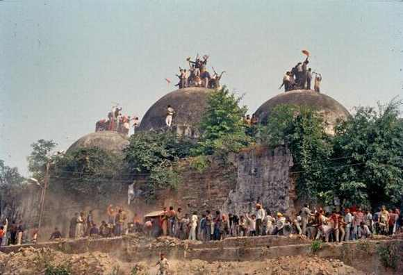 Mobs demolish the Babri Masjid in Ayodhya, December 6, 1992.
