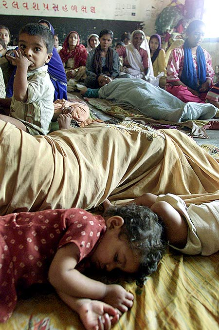 Children sleep at a relief camp in Ahmedabad in 2002
