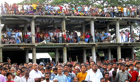 Villagers affected by ethnic riots gather at a relief camp in Bilashipara town