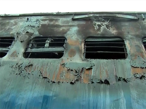 A charred bogie of the Tamil Nadu Express