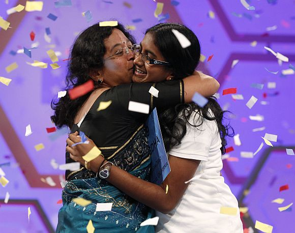 Snigdha celebrates with her mother after winning the Scripps National Spelling Bee