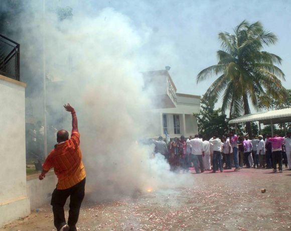 Supporters of YSR Congress chief Jaganmohan Reddy celebrate his victory