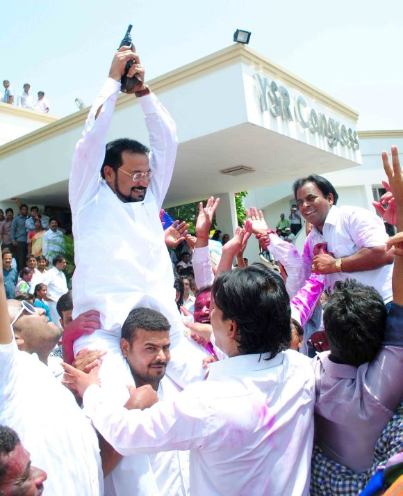 Ex MLC Rahman fires in the air at the YSR Congress party office at Jubilee Hills in Hyderabad