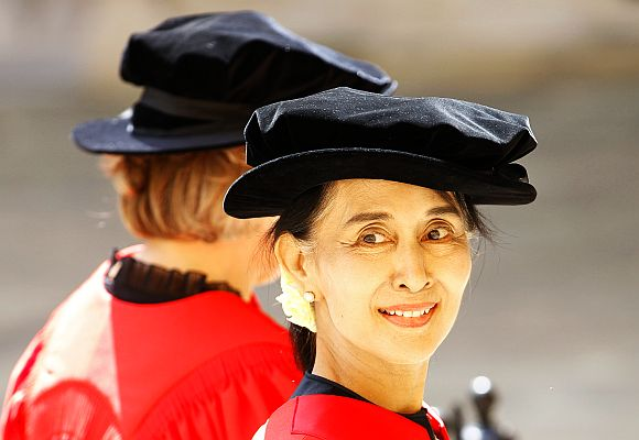Aung San Suu Kyi processes towards the Sheldonian theatre to receive her honorary degree at Oxford University