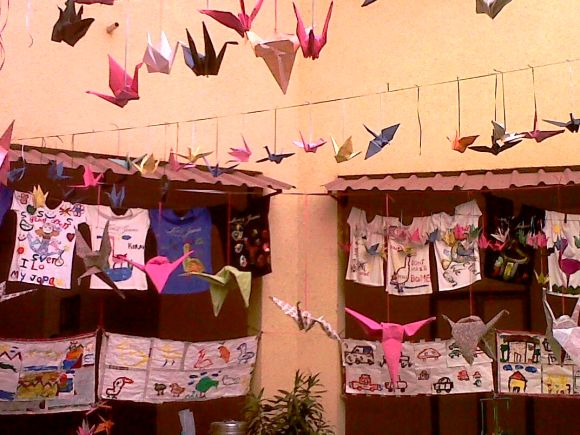 Origami cranes, T-shirts displayed as a part of the 1000 Crane Project