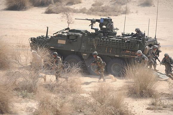 Indian and US troops exit the Stryker armoured fighting vehicle